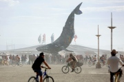 Participants gather around The Space Whale art installation as approximately 70,000 people from all over the world gather for the 30th annual Burning Man arts and music festival in the Black Rock Desert of Nevada, U.S. August 29, 2016. Picture taken August 29, 2016. REUTERS/Jim Urquhart FOR USE WITH BURNING MAN RELATED REPORTING ONLY. FOR EDITORIAL USE ONLY. NO RESALES. NO ARCHIVES. NOT FOR SALE FOR MARKETING OR ADVERTISING CAMPAIGNS. NO THIRD PARTY SALES. NOT FOR USE BY REUTERS THIRD PARTY DISTRIBUTORS - RTX2NK48
